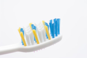 close up view of toothbrush bristles on white background